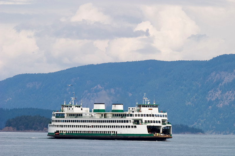 A ferry boat on a Washington State waterway is used to transport cars and passengers.