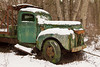 An old truck, abandoned on a side road for years, has been sitting quietly and rusting.