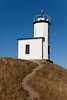 The Cattle Point lighthouse on San Juan Island lies at the end of a winding dirt path that leads up the hill.