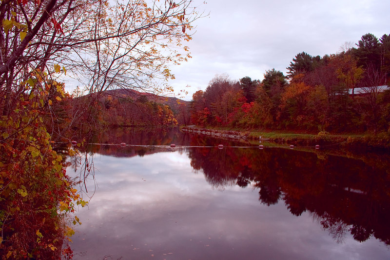 """The Ottauquechee River - There is a saying among photographers, """"Don't forget to look behind you."""" Sometimes the view in the opposite direction can be even better than the one in front of you. The covered bridge is just behind me. I can't decide which is the better view."""
