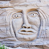 A primeval face appears in the cliffs on Waldron Island in the San Juan Islands of Washington State. This sand sculpture is carved into the side of a sandy cliff.