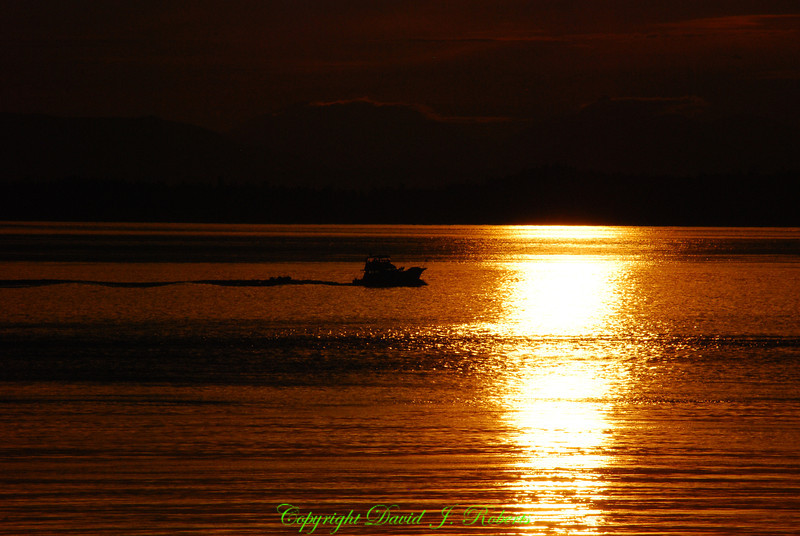Sunset and boat from San Juan County Park, San Juan Island, Washington