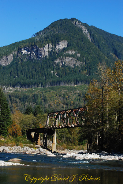 Old railway trestle over the Skykomish River east of Skykomish WA on US Highway 2, Washington