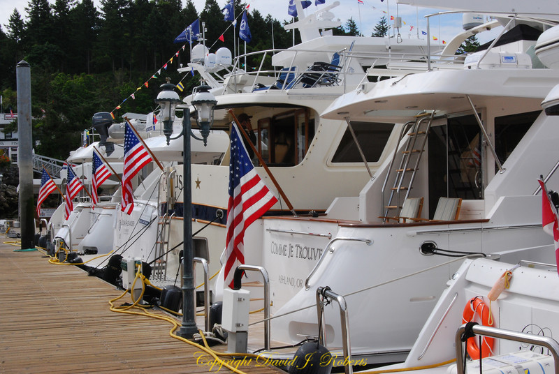 Fancy vessels for sale at Roche Harbor dressed up for July 4th.