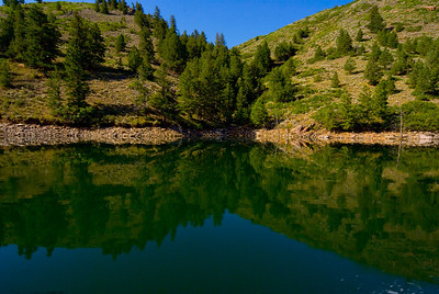 Reflections on the water in Lake Fork Arm at Blue Mesa Lake near Gunnison Colorado