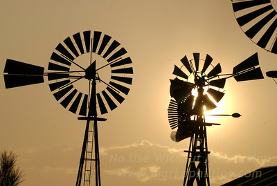 Wind vanes at sunset in Peyton, Colorado