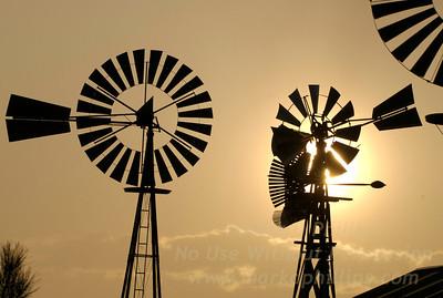 Wind vanes at sunset in Peyton, Colorado