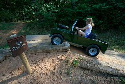 Eliza Phillips drives a miniature Range Rover on family trip to Biltmore Estate in Asheville, NC, in 2007