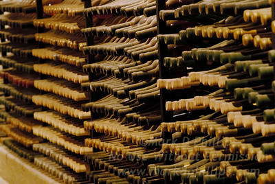 Wine bottles line the racks on the walls of the cellar at Biltmore Estate in Asheville, NC.