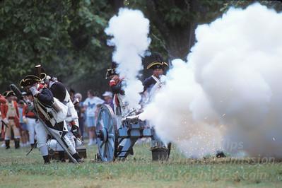 American Revolutionary reenactors fire off a cannon at Colonial Williamsburg in Williamsburg, Virginia.