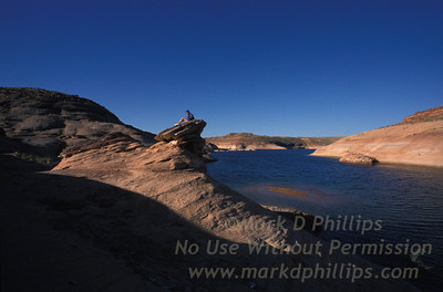 Dennis Kiewra sits on an outcrop above the water at Lake Powell, Utah.