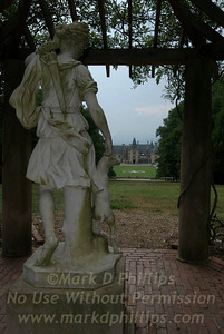 Statue at Biltmore Estate with main house in background