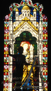 Cleaning and restoring stained glass at a church in Augusta, Georgia.