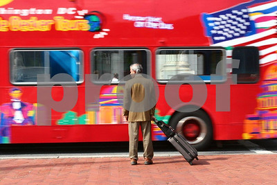 In Washington, DC a man waits for a bus to pass at Union Station.