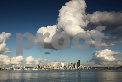 Big clouds hang over the Seattle skyline, viewing east over the Duwamish Waterway from West Seattle.