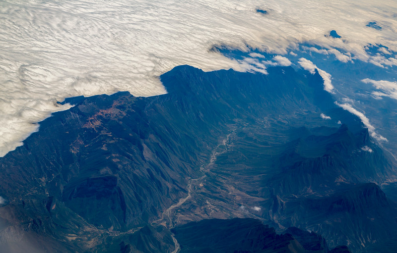 Clouds spill over the mountains of NE Mexico.