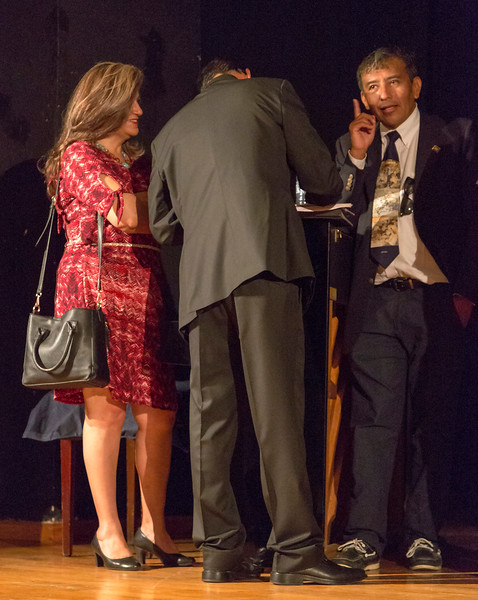 Abel (right) chatting with choral director and his wife