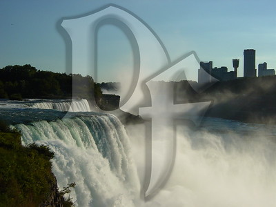 View of the American Falls with mist from the Horseshoe Falls rising in the distance. Niagara Falls, NY
