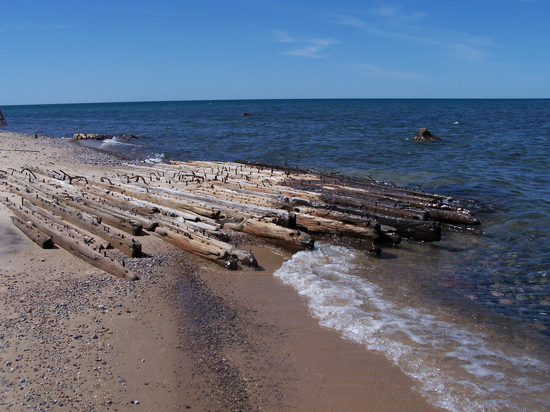 The Gale Staples was carrying coal when it was caught in a fierce storm and grounded in 1918. Its crew was rescued as well.<br /> <br /> The long iron treenails -- fasteners that held the bones of the boat together -- rise eerily from the remains of all the wrecks.