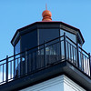 The top of the restored Sand Point Light came from the lighthouse on Poverty Island. A Fourth Order Fresnel lens completes the authenticity of the restoration.