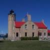 Old Mackinac Point Lighthouse. The castle-like structure, whose design is unique in the Great Lakes, has been restored to its 1910 appearance. It is constructed of Cream City brick trimmed with Indiana limestone.