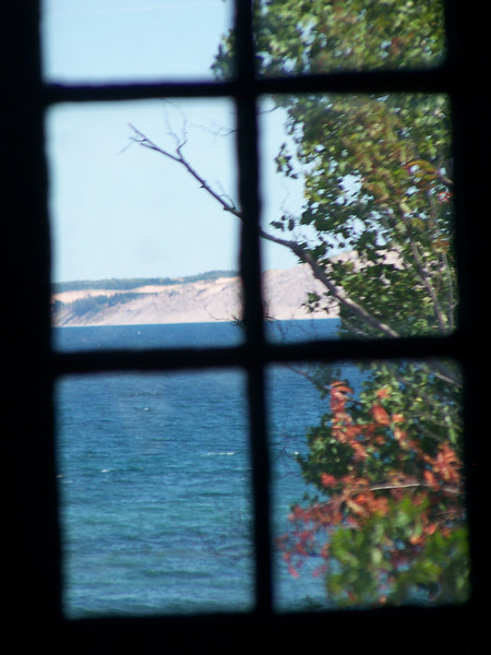 View through the window of the fog signal building to the beautiful Grand Sable Dunes.