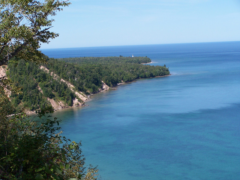 View from the wooden platform that juts out over the 300' sand dunes at Log Slide. In the distance is Au Sable Lighthouse, 3.5 miles to the west.