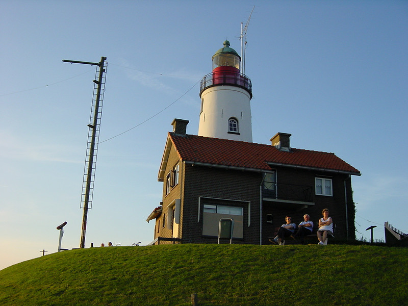 People of Urk sitting in front of their house. The guy in the middle looks like the lighthouse operator...