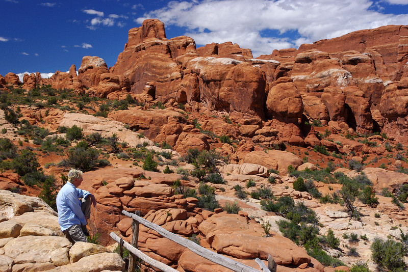 Rita in a landscape with rocks; Arches National Park, Utah.