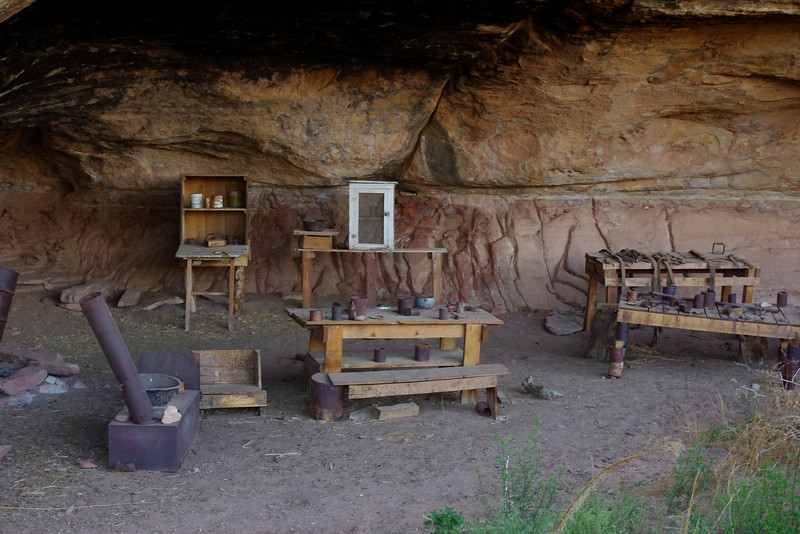 Old cowboy camp on the Cave Spring Trail, Canyonlands National Park (Needles District), Utah. Before Canyonlands became a National Park, cattle were grazed on the sparse grass there. This overhanging bluff provided shade and a small spring; Cowboys, like the Natives before them, used the hollow bluff for shelter.