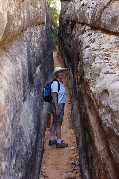 Rita, in a tight place, Chesler Park Trail, Canyonlands National Park, Utah.