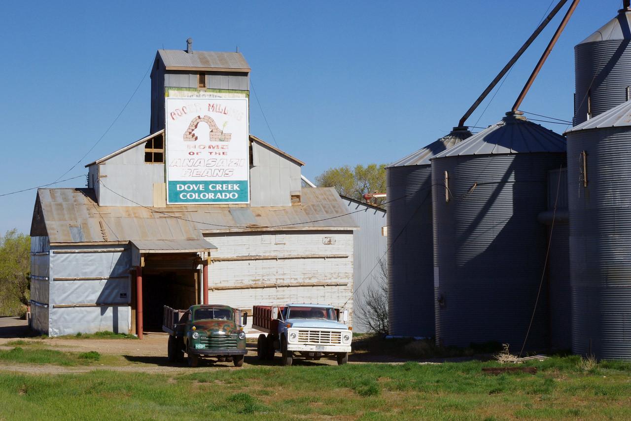 Adobe Bean Mill, Dove Creek, Colorado, with trucks.
