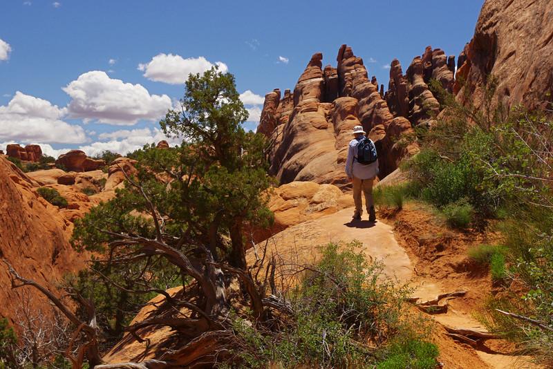 Rita hiking the primitive trail, Arches National Park, Utah.