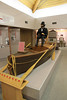 A replica of Powell's boat and presumably one of the man himself.