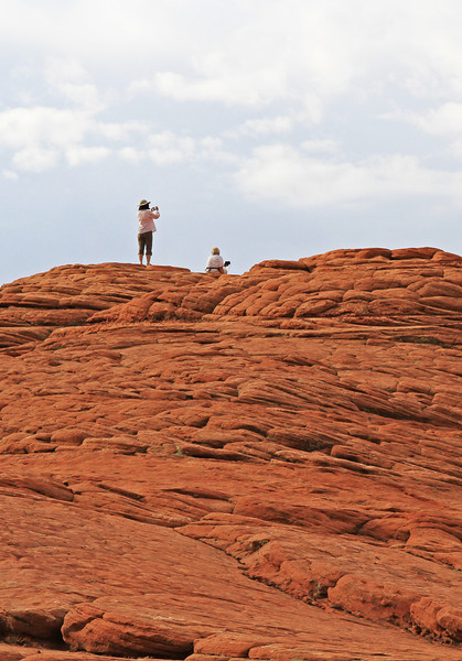 Steffie and Rona on a petrified sand dune in Snow Canyon.