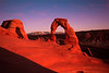 Arches National Park. This is one of the moments that brings so many visitors up the Delicate Arch Trail. Right before the sun dips below the horizon it lights up the arch with a fiery glow.