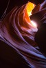 Upper Antelope Canyon. Wide extremes in light range make traditional histogram adjustments difficult.  To save the hot spots, most of these canyon shots were underexposed if judged by normal standards. Shadow enhancements pulled out the undertones.