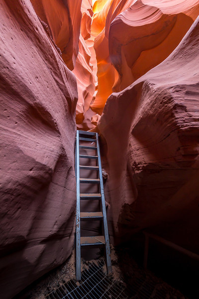Lower Antelope Canyon. Going up and down the handrail-free ladders with a tripod and two cameras was dicey. Colors near the opening were fairly normal (as seen here), but as I went deeper and further from the sun the magic colors of deep red and purple took over.