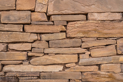 Background image of an ancient stone wall on the ruins of an old home