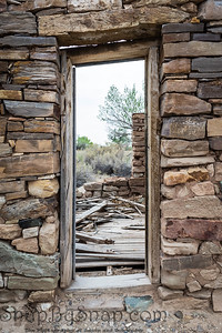 Looking through the door in the stone ruins of an old house