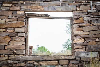 Looking through the window in the stone ruins of an old house