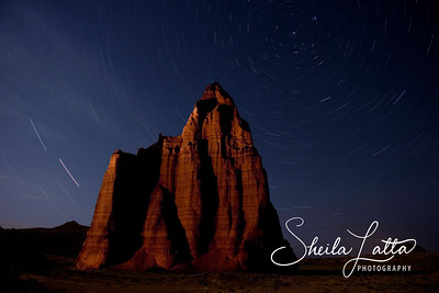Cathedral of the moon timed exposure.  Thirty minutes at night.  The light on the monolith was from a 2 million candlelight flashlight.   Cathedral Valley
