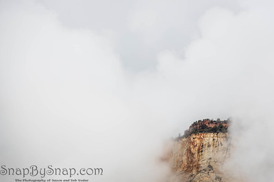 A sky island image in Utah's Zion Nation Park formed by clouds moving around a mountain peak