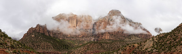 Panorama of the mountains of Zion National Park in Utah with a heavy overcast and clouds dramatically passing in from of the peaks.