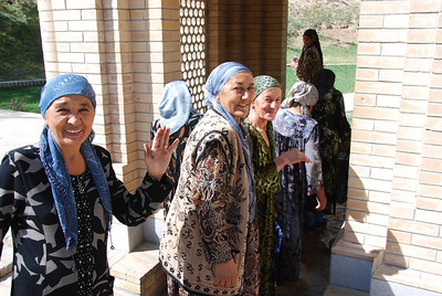 Local ladies queueing to collect pots of the holy water from the spring at Daniel's tomb.  The headscarf indicates that the wearer is married.  Though Muslim, the majority of Uzbeki women do not wear the hijab.