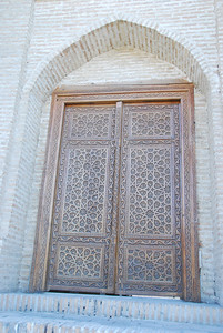 Most of the mosques in Bukhara were closed during Russian rule. While some have reopened others, like this one, are just beautiful doors with nothing inside, you can see daylight under the door on the right hand side..