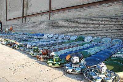 Acres of tea sets and bowls for sale on the footpath.