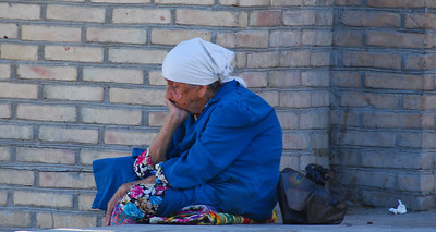 Its been a hard day.  An elderly lady taking a break on the steps of the Kalon Mosque.