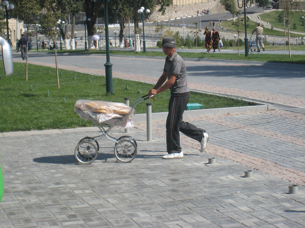 Samarkand is a city where old prams have a new purpose for bread delivery.