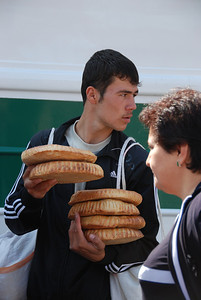 Bread sellers at Samarkand station. The bread is called 'non'.